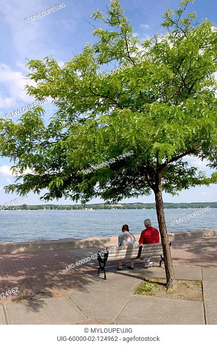Couple on pier on Canandaigua Lake in the Finger Lakes region of New Yrok State