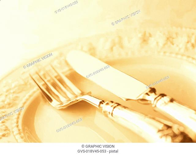 Close Up of a Knife and Fork on a Plate