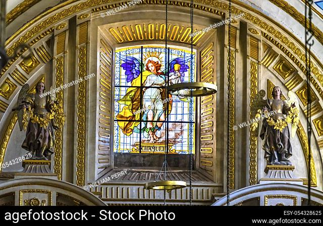 Colorful Angel Chamuel of Loving Relations Stained Glass Angel Statues Basilica Cathedral Puebla Mexico. Built in 15 to 1600s. Chamuel Loving One