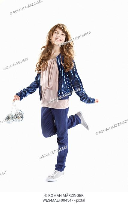 Girl with disco ball, smiling, portrait