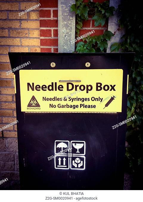 Needle Drop Box in a public park, Ontario, Canada. Such boxes are designed to encourage safe disposal of needles commonly used by drug addicts and often dumped...