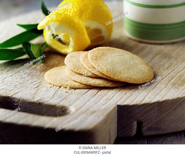 Lemon shortbread thins on vintage wooden cutting board