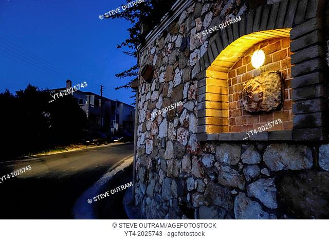 Luxury Villa Wall in Crete Greece showing Stone Carving of Alexander The Great,