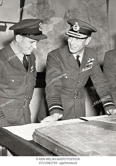 King George VI, right, meets Guy Gibson, on his return from leading the successful raid by R. A. F. bombers on the great Ruhr dams in May, 1943