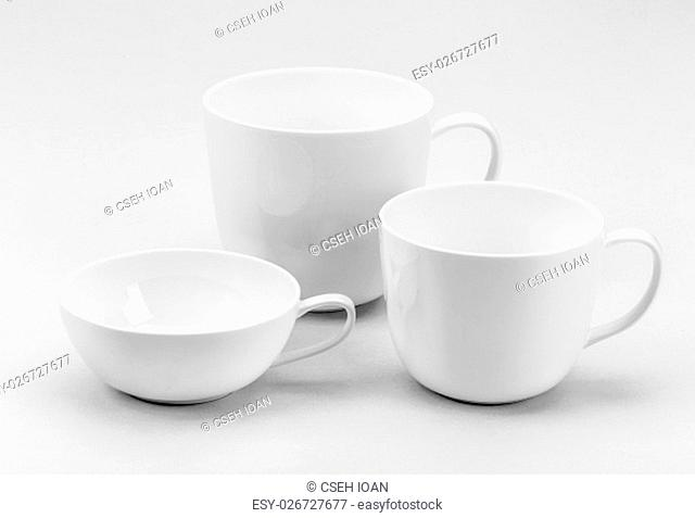 Collection of various white coffee or tea cups