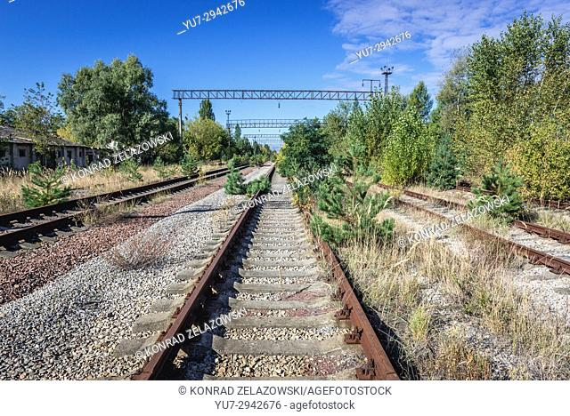 Railway tracks of abandoned Yaniv town railway station, Chernobyl Nuclear Power Plant Zone of Alienation around nuclear reactor disaster in Ukraine