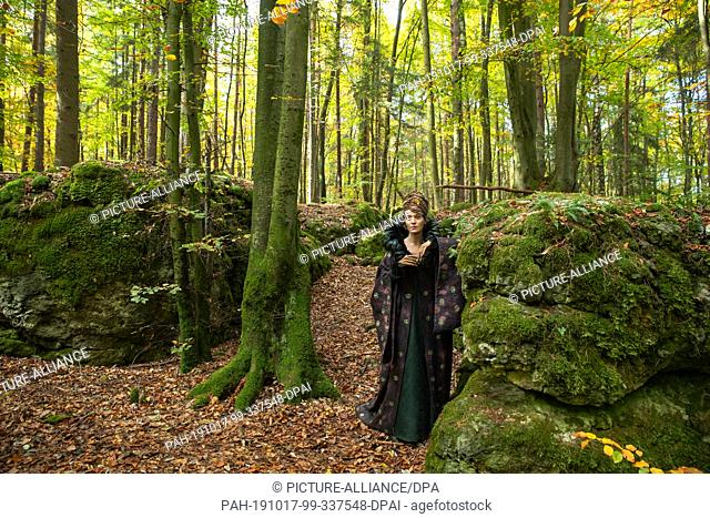 17 October 2019, Bavaria, Wiesenttal: The actress Jeanette Hain, in the role of the guardian of the air spirits, stands on the edge of the shooting for the ARD...