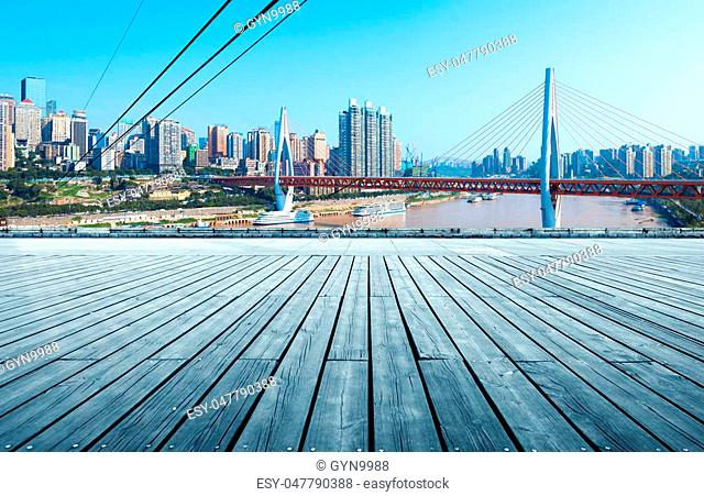 Wooden floor in front of the city skyline, Chongqing, China