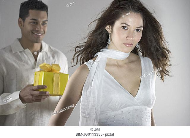 Portrait of couple with wrapped gift