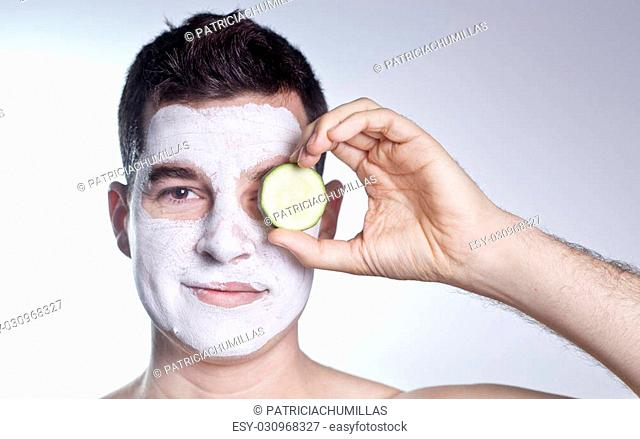 man with facial and cucumber