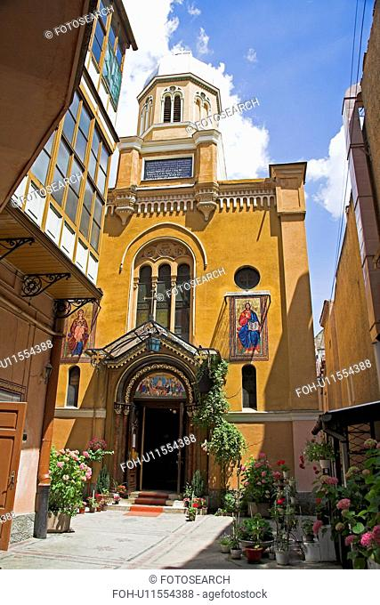Ochre painted traditional church in Transylvania in Romania&#10