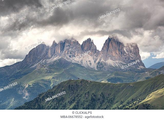 Europe, Italy, Trentino, Dolomites. Sassolungo in a day of clouds photographed from Marmolada