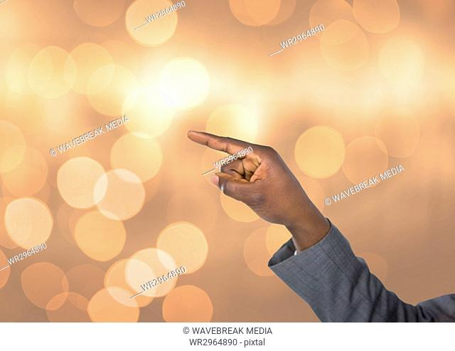 Hand pointing angular with sparkling light bokeh background