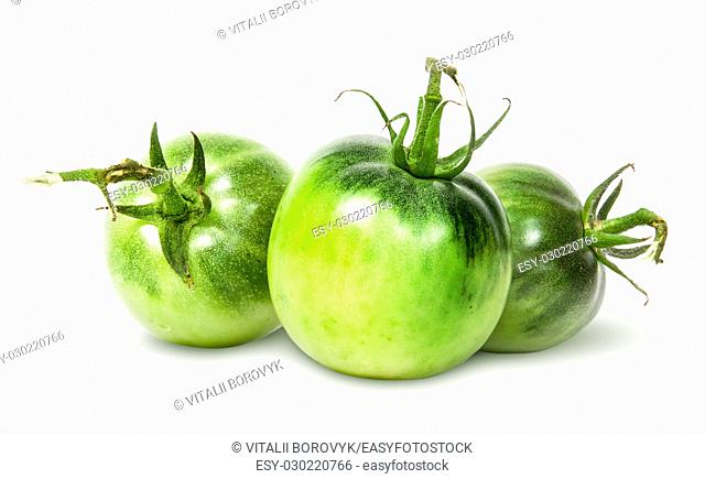 In front three green tomatoes near isolated on white background