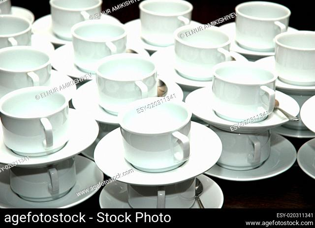 Cups and saucers stacked on top of each other