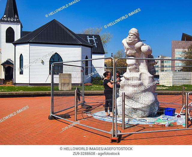 The Scott Antarctic Memorial being repaired in 2018 with the Norwegian Church in the background, Cardiff Bay, Cardiff, Wales, United Kingdom