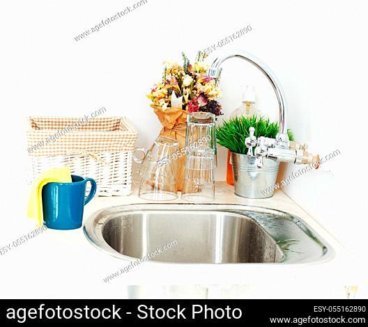Kitchen, housework. Blue tea cup in the sink