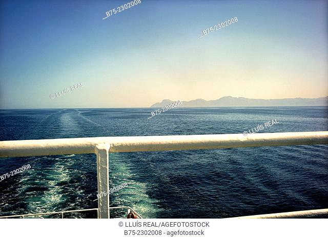 Given the wake of a boat and Mallorca island on the horizon from the stern of a passengers ship. Balearic Islands, Mediterranean Sea, Spain, Europe