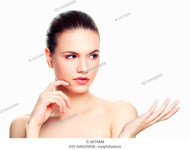 Thinking woman showing empty copy space on the open hand isolated on white background
