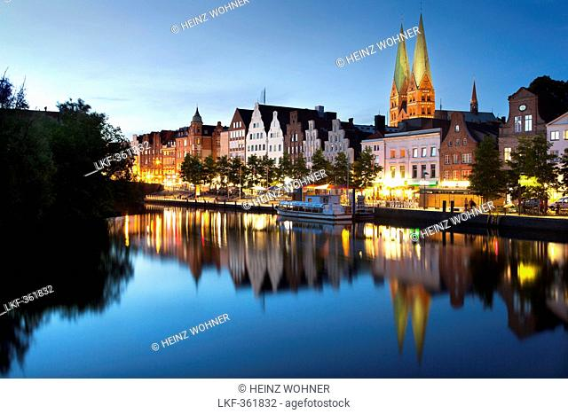 View over the Trave river to the old town of Luebeck with St Mary's church, Hanseatic city of Luebeck, Baltic Sea, Schleswig-Holstein, Germany
