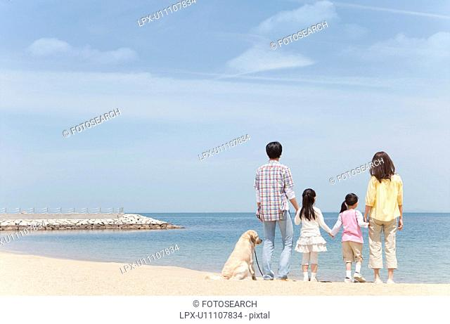 Family of Four and Dog on Beach