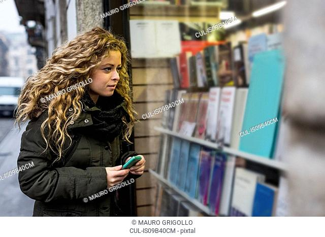 Woman window shopping, Milan, Italy