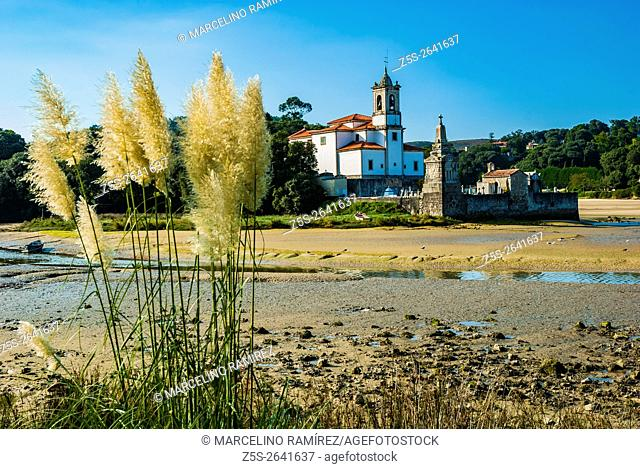 Neoclassical church Our Lady of Sorrows and Niembro Cemetery at low tide. Niembro, LLanes, Asturias, Spain