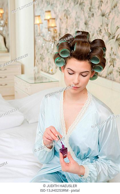 young woman with nailpolish on bed