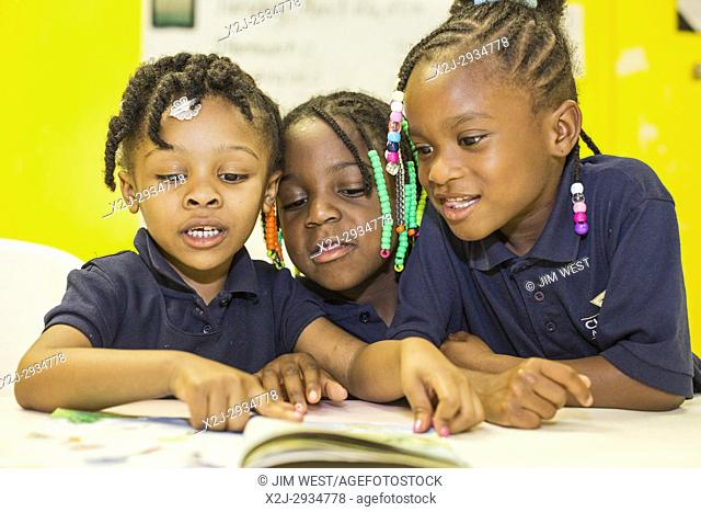 Spartanburg, South Carolina - Children read during the S. O. A. R. after school program at the Bethlehem Center, a community center serving the African-American...