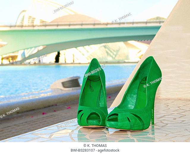 green high heels on a tessellated sill at the 'Ciudad de las Artes y de las Ciencias', the 'City of Arts and Sciences', Spain, Valencia