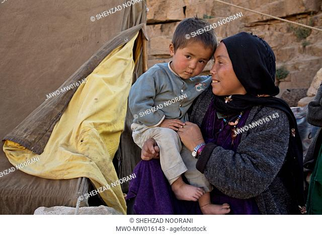 A nomad mother with her child, outside her tent, in the village of Dar-e-Buzgala, in the central Bamyan Province Their community consists of 10 families