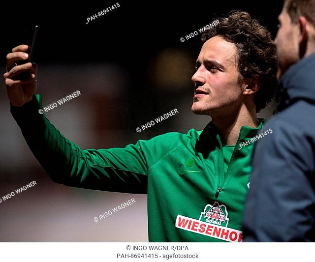 New team member Thomas Delaney of the Bundesliga soccer club Werder Bremen takes a selfie with a journalist after the first training session for the second half...
