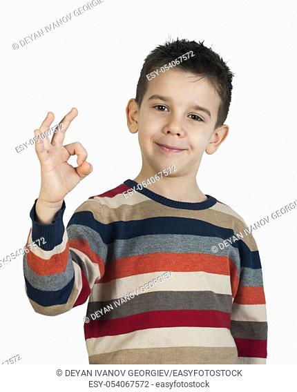 Child showing success symbol. White isolated studio shot