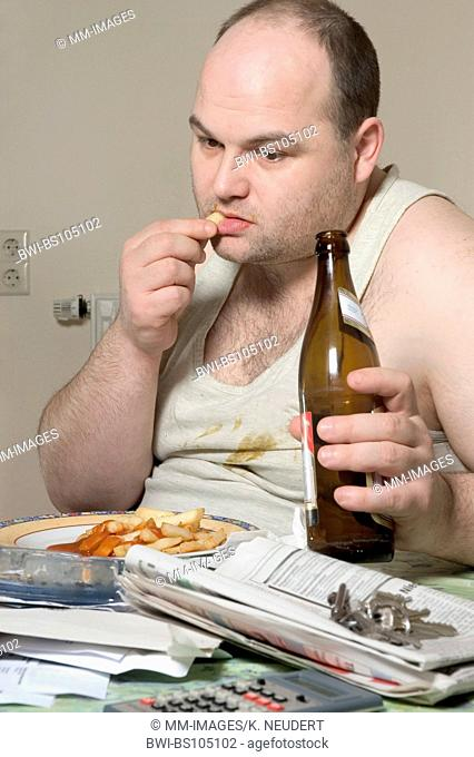 man in undershirt eating french fries and drinking beer, Ruhr Area