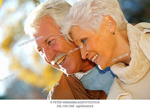 Happy senior couple in autumn