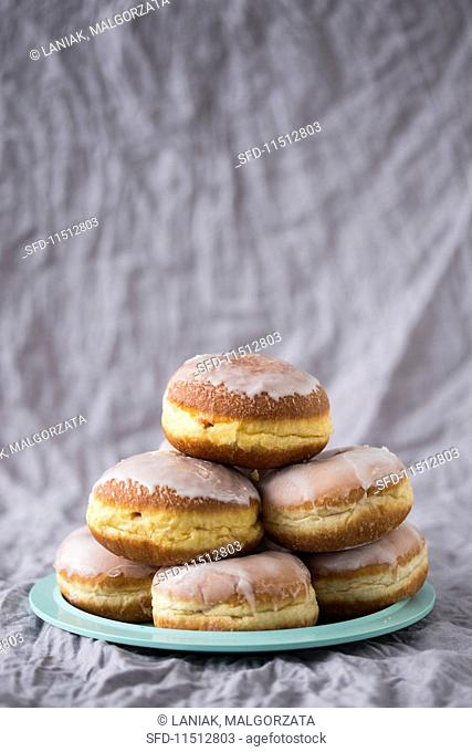 A stack of traditional Polish doughnuts filled with marmalade