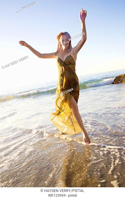 Young Woman Celebrating On Beach