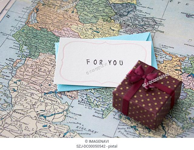 Gift box and a letter on a map