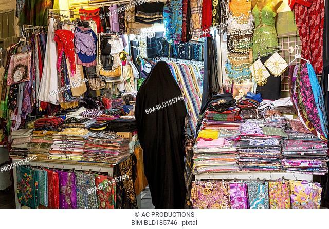 Woman shopping in fabric market