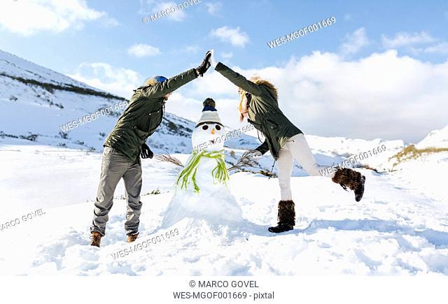 Spain, Asturias, couple with a snowman