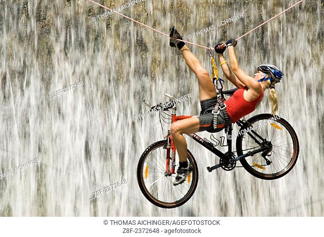 Crossing the waterfall with the bike