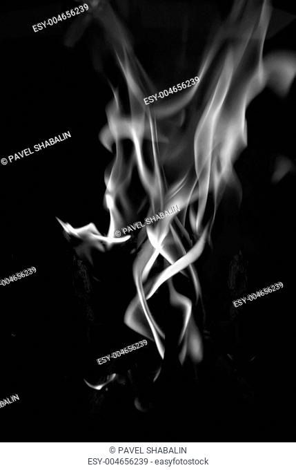 Smoke flame tongue on black background