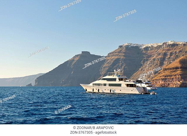 greece santorini island coast with luxury yacht