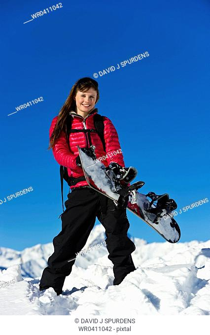A snowboarder having fun in the snowy mountains