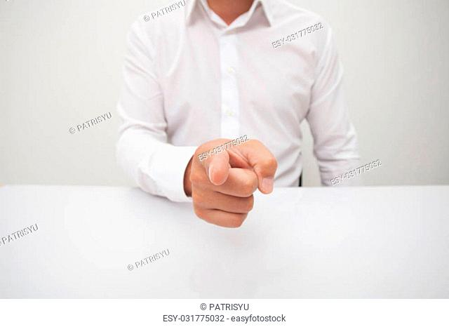 Businessman pointing at camera with his finger