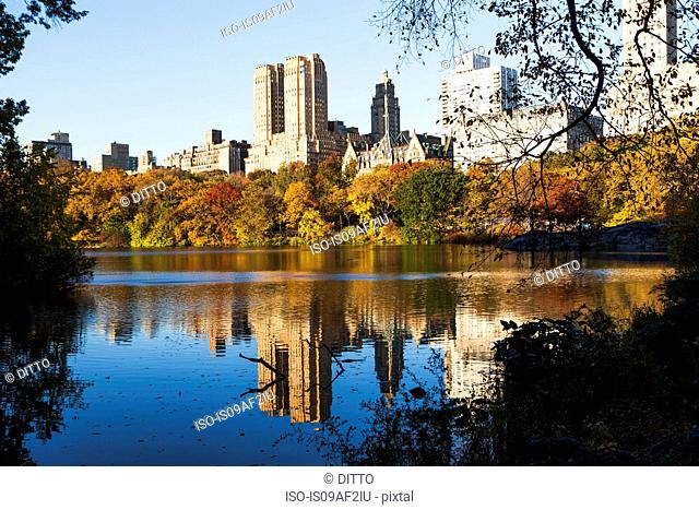 Reflections in Central Park lake, New York City, USA
