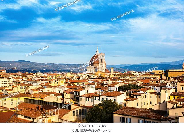 Elevated view of rooftops and the Duomo (Florence Cathedral) and distant hills, Florence, Italy