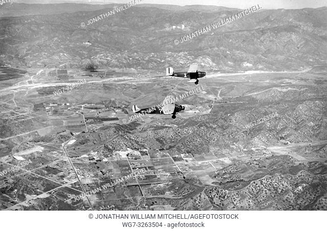 "USA Burbank -- 04 Jan 1929 -- Refueling the ""?"" (a test aircraft marked with a ? as it's identification number!) over Burbank, USA"
