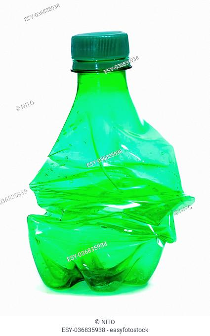 smashed green plastic bottle, on a white background