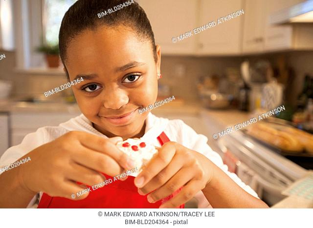 African American girl baking in kitchen
